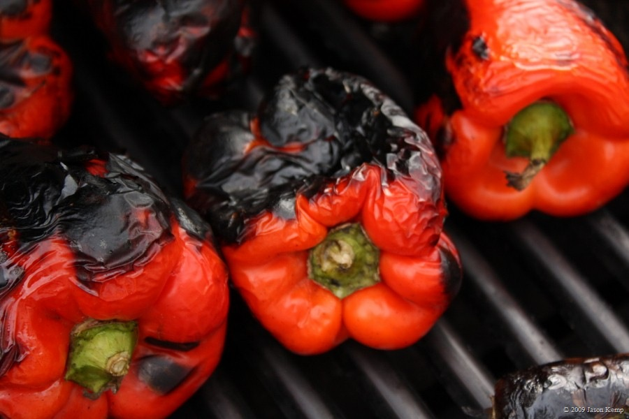 This is what you want your peppers to look like right before you take them off the grill; black and charred and none too pleasant.